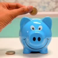 putting money into a piggy bank